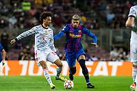 14th September 2021: Nou Camp, Barcelona, Spain: ECL Champions League football, FC Barcelona versus Bayern Munich: Araujo challenges Leroy Sane of Bayern