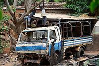 BURKINA FASO , Bobo Dioulasso, children play on truck wreck / Kinder spielen auf einem LKW Wrack