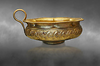 Mycenaean gold cup with ivy leaf decoration from the Mycenaean cemetery of Midea tomb 10, Dendra, Greece. National Archaeological Museum Athens Cat no 8743.  Grey art Background