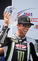 Martin Cardenas raises his trophy after winning the Daytona Sportbike race at the AMA Superbike Showdown at Road Atlanta, Braselton, GA, April 2010.  (Photo by Brian Cleary/www.bcpix.com)