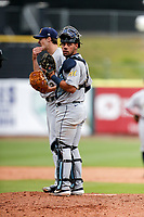 Montgomery Biscuits catcher Rene Pinto (11) takes part in a meeting on the mound during the game against the Tennessee Smokies on May 9, 2021, at Smokies Stadium in Kodak, Tennessee. (Danny Parker/Four Seam Images)