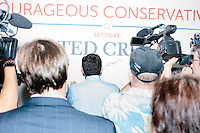 Texas senator and Republican presidential candidate Ted Cruz signs a wall after speaking to a crowd at the kick-off event at his New Hampshire campaign headquarters in Manchester, New Hampshire. Cruz invited everyone assembled to add their signature and comments to the wall.