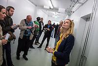 """Am Freitag den 10. Juli 2015 wurde der erste von zwei Containerunterkuenften fuer Fluechtlinge aus dem Buergerkrieg in Syrien im Berliner Bezirk Marzahn-Hellersdorf bei einem """"Tag der offenen Tuer"""" der Presse vorgefuehrt.<br /> Gegen die Errichtung der zwei Containerunterkuenfte haben mehrere Monate Anwohner sowie Nazis und Hooligans aus Berlin und Brandenburg protestiert. Zum Schutz der Containerunterkuenfte vor rassistischen Protesten waren Mitarbeiter einer Securityfirma und eine Hunderschaft der Polizei vor Ort.<br /> Im Bild:  Journalisten lassen sich von Frau Jutta Hermenau, Mitarbeiterin der Betreiberfirma Prisod, Wohnheimbetriebs GmbH (rechts im Bild), die Unterkunft erklaeren.<br /> 10.7.2015, Berlin<br /> Copyright: Christian-Ditsch.de<br /> [Inhaltsveraendernde Manipulation des Fotos nur nach ausdruecklicher Genehmigung des Fotografen. Vereinbarungen ueber Abtretung von Persoenlichkeitsrechten/Model Release der abgebildeten Person/Personen liegen nicht vor. NO MODEL RELEASE! Nur fuer Redaktionelle Zwecke. Don't publish without copyright Christian-Ditsch.de, Veroeffentlichung nur mit Fotografennennung, sowie gegen Honorar, MwSt. und Beleg. Konto: I N G - D i B a, IBAN DE58500105175400192269, BIC INGDDEFFXXX, Kontakt: post@christian-ditsch.de<br /> Bei der Bearbeitung der Dateiinformationen darf die Urheberkennzeichnung in den EXIF- und  IPTC-Daten nicht entfernt werden, diese sind in digitalen Medien nach §95c UrhG rechtlich geschuetzt. Der Urhebervermerk wird gemaess §13 UrhG verlangt.]"""