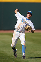 Christoph Bono #3 of the UCLA Bruins makes a throw during a game against the Washington Huskies at Jackie Robinson Stadium on March 17, 2013 in Los Angeles, California. (Larry Goren/Four Seam Images)