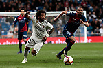 Real Madrid's Marcelo Vieira and SD Huesca's Serdar Gurler during La Liga match between Real Madrid and SD Huesca at Santiago Bernabeu Stadium in Madrid, Spain.March 31, 2019. (ALTERPHOTOS/A. Perez Meca)