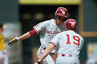 Peyton Graham (20) of the Oklahoma Sooners slaps hands with his third base coach after hitting a home run during the game against the Missouri Tigers in game four of the 2020 Shriners Hospitals for Children College Classic at Minute Maid Park on February 29, 2020 in Houston, Texas. The Tigers defeated the Sooners 8-7. (Brian Westerholt/Four Seam Images)