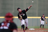 Nebraska Emmett Olson (38) pitches, Monday, June 7, 2021 in the seventh inning of the NCAA Fayetteville Regional at Baum-Walker Stadium in Fayetteville. Check out nwaonline.com/210608Daily/ for today's photo gallery. <br /> (NWA Democrat-Gazette/Charlie Kaijo)