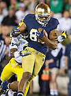 Sept. 6, 2014; Irish wide receiver Corey Robinson rushes for a 22-yard gain during the first half against Michigan. (Photo by Barbara Johnston/ University of Notre Dame)