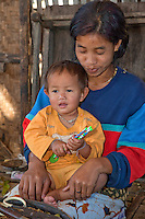 Myanmar, Burma.  Burmese Woman of Intha Ethnic Group and her Son, Inle Lake, Shan State.