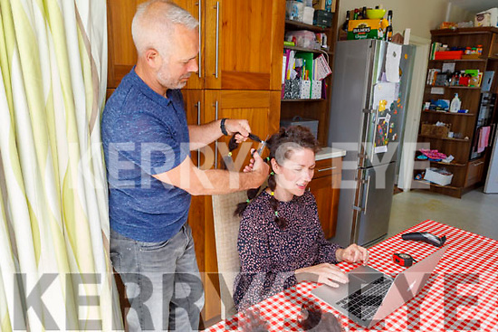 Jennifer Long getting her hair cut by her husband Fergal for Down Syndrome Kerry at home in Beaufort on Saturday morning.
