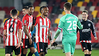 Brentford's Ivan Toney celebrates their victory at the end of the match with Brentford goalkeeper, Luke Daniels during Brentford vs Newcastle United, Carabao Cup Football at the Brentford Community Stadium on 22nd December 2020