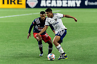 FOXBOROUGH, MA - APRIL 24: Edison Flores #10 of D.C. United dribbles as Christian Mafla #32 of New England Revolution defends during a game between D.C. United and New England Revolution at Gillette Stadium on April 24, 2021 in Foxborough, Massachusetts.