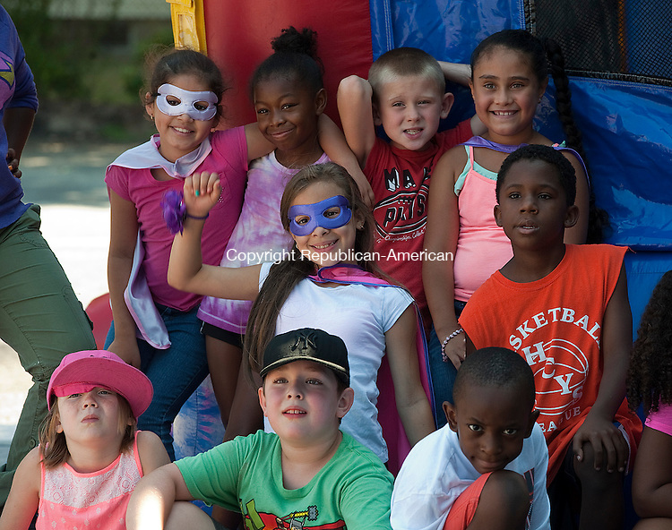 WATERBURY, CT--- -081415JS10- Kids pose for a photo on Super Hero day during Camp Summer Sunshine Friday at Chase School in Waterbury. Jim Shannon Republican-American
