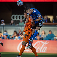 SAN JOSE, CA - JULY 24: Sam Junqua #29 of the Houston Dynamo goes up for a header with Nathan #13 of the San Jose Earthquakes during a game between San Jose Earthquakes and Houston Dynamo at PayPal Park on July 24, 2021 in San Jose, California.