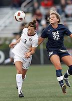 Harvard University midfielder Meg Casscells-Hamby (3) heads the ball as Yale University defender Shannon McSweeney (22) closes. In overtime, Harvard University defeated Yale University,1-0, at Soldiers Field Soccer Stadium, on September 29, 2012.