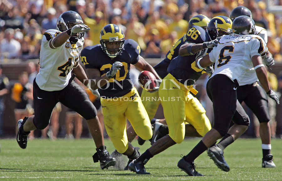 1 September 2007: Michigan running back Mike Hart rushes with the ball in the 2007 season opener college football game between the Michigan Wolverines and Appalachian State Mountaineers at Michigan Stadium in Ann Arbor, MI. No. 5 ranked Michigan was upset 32-34.