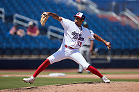 Kannapolis Cannon Ballers relief pitcher Garvin Alston (15) in action against the Lynchburg Hillcats at Atrium Health Ballpark on August 29, 2021 in Kannapolis, North Carolina. (Brian Westerholt/Four Seam Images)