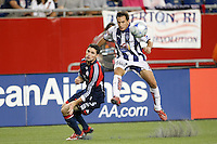 Pachuca CF midfielder Christian Gimenez (19) crosses the ball past New England Revolution defender Jay Heaps (6). The New England Revolution defeated Pachuca CF 1-0 during a Group B match of the 2008 North American SuperLiga at Gillette Stadium in Foxborough, Massachusetts, on July 16, 2008.