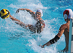 Waterpolo action photography. La Serna High School player takes a shot against Troy High School