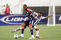 Pachuca CF defender Julio Cesar Manzur (3) and New England Revolution midfielder Khano Smith (18). The New England Revolution defeated Pachuca CF 1-0 during a Group B match of the 2008 North American SuperLiga at Gillette Stadium in Foxborough, Massachusetts, on July 16, 2008.