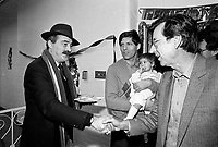 December 19, 1987 File Photo - Montreal, Quebec, CANADA -  Robert Bourassa, Quebec Premier attend Sun Youth fundraiser pasta supper.<br /> <br /> In photo : Nick Auf Der Maur (L), Jacques Chagnon and his baby (M) and  Robert Bourassa, (R)