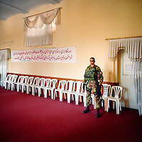 Italian ISAF soldier in a Herat council meeting. ISAF (the International Security Assistance Force) is a peacekeeping mission affiliated to the United Nations (UN) and NATO.