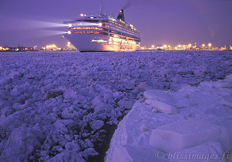 Silja Europa departs ice-jammed Turku harbour at twilight.