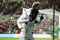 Wednesday, 01 January 2014<br /> Pictured: Wilfried Bony of Swansea (R) celebrating his equaliser with team mate Jose Canas (L), making the score 1-1.<br /> Re: Barclay's Premier League, Swansea City FC v Manchester City at the Liberty Stadium, south Wales.