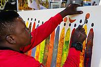 """Tanzania.  Mto wa Mbu. Artist Painting in """"Kisu"""" (Knife) Style."""