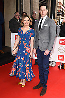 Emelia Fox and David Caves<br /> arriving for theTRIC Awards 2020 at the Grosvenor House Hotel, London.<br /> <br /> ©Ash Knotek  D3561 10/03/2020