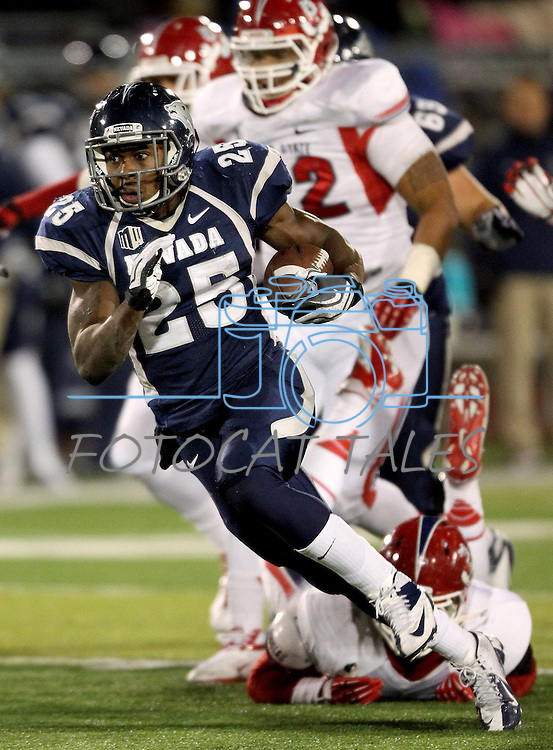 Nevada's Stefphon Jefferson (25) runs up the middle against Fresno State during the first half of an NCAA college football game in Reno, Nev., on Saturday, Nov. 10, 2012. (AP Photo/Cathleen Allison)