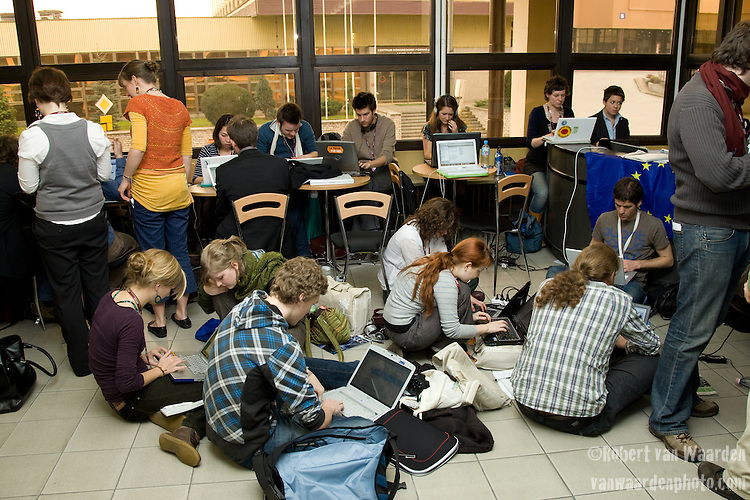 International Youth Delegates working away at the COP. UNFCCC COP 14 (©Robert vanWaarden ALL RIGHTS RESERVED)