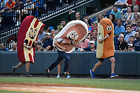 Between innings race during the Greenville Drive game against the Charleston RiverDogs on Thursday, July 27, 2017, at Fluor Field at the West End in Greenville, South Carolina. Charleston won, 5-2. (Tom Priddy/Four Seam Images)