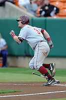 Florida State Seminoles first baseman John Nogowski #3 runs to first during a game against the Clemson Tigers at Doug Kingsmore Stadium on March 22, 2014 in Clemson, South Carolina. The Seminoles defeated the Tigers 4-3. (Tony Farlow/Four Seam Images)
