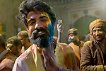 A man smears gulal on a boy during the festival of Holi at Vrindavan. Holi - The  Hindu festival of colour is celibrated for a week in the Brraj region of Uttar Pradesh, India.