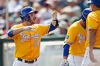 UC Santa Barbara Gauchos catcher Dempsey Grover (20) celebrates with his teammates after scoring against the Miami Hurricanes in Game 5 of the NCAA College World Series on June 20, 2016 at TD Ameritrade Park in Omaha, Nebraska. UC Santa Barbara defeated Miami  5-3. (Andrew Woolley/Four Seam Images)