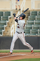 Seamus Curran (34) of the Delmarva Shorebirds follows through on his swing against the Kannapolis Intimidators at Kannapolis Intimidators Stadium on June 3, 2019 in Kannapolis, North Carolina. The Shorebirds defeated the Intimidators 5-3. (Brian Westerholt/Four Seam Images)