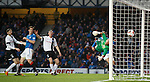 Jon Daly rises to head in the opening goal for Rangers past Ayr Utd keeper David Hutton