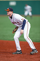 Virginia Cavaliers first baseman Pavin Smith (10) on defense against the Hartford Hawks at The Ripken Experience on February 27, 2015 in Myrtle Beach, South Carolina.  The Cavaliers defeated the Hawks 5-1.  (Brian Westerholt/Four Seam Images)