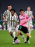 Football Soccer: UEFA Champions League -Group Stage-  Group G - Juventus vs FC Barcellona, Allianz Stadium. Turin, Italy, October 28, 2020.<br /> Barcellona's Pedri (r) in action with Juventus' Juan Cuadrado (l) during the Uefa Champions League football soccer match between Juventus and Barcellona at Allianz Stadium in Turin, October 28, 2020.<br /> UPDATE IMAGES PRESS/Isabella Bonotto