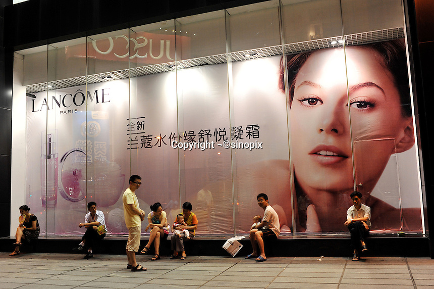An advertisement for Lancome in Guangzhou, China. The financial crisis won't have too much impact on Chinese consuming market. According to a survey by Nielsen of 50 countries and regions, only 35 percent of Chinese people believed the domestic economy was in a contraction. The figure was the lowest among the 50 world markets..