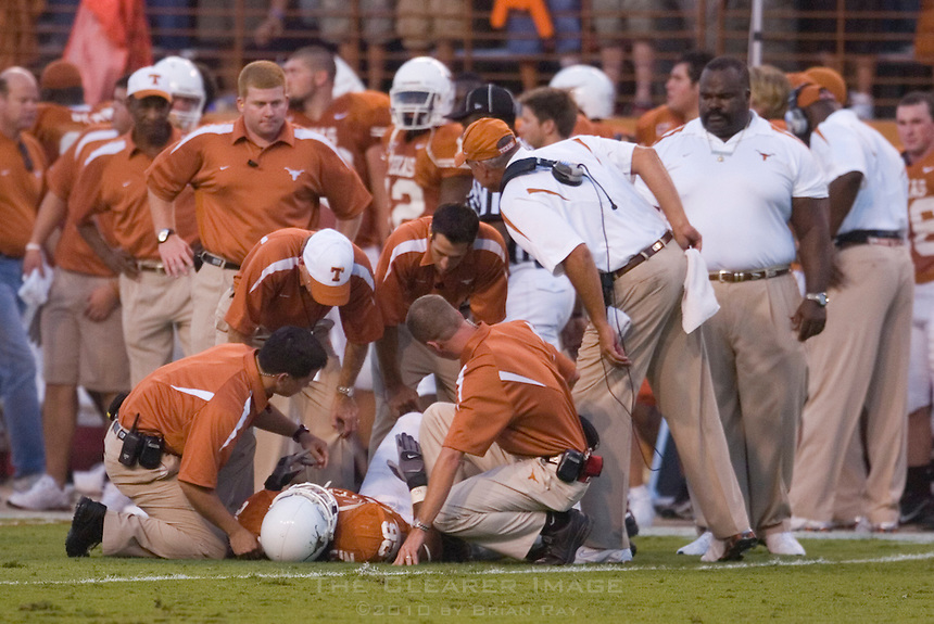09 September 2006: Texas athletic trainers and coaches tend to defender Marcus Griffin who was shaken up on a big play during the Longhorns 24-7 loss to the Ohio State Buckeyes at Darrell K Royal Memorial Stadium in Austin, TX.
