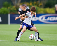 Ali Krieger (11) of the USWNT tries to take the ball away from Mana Iwabuchi (20) of Japan during the game at WakeMed Soccer Park in Cary, NC.   The USWNT defeated Japan, 2-0.