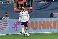 FOXBOROUGH, MA - APRIL 24: Brendan Hines-Ike #4 of D.C. United passes the ball during a game between D.C. United and New England Revolution at Gillette Stadium on April 24, 2021 in Foxborough, Massachusetts.