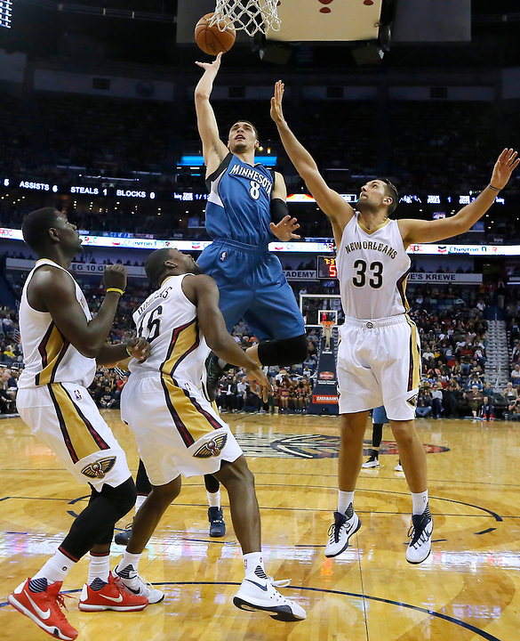 Minnesota Timberwolves guard Zach LaVine (8) shoots over New Orleans Pelicans guard Jrue Holiday, left, guard Toney Douglas (16) and forward Ryan Anderson (33) during the second half of an NBA basketball game Saturday, Feb. 27, 2016, in New Orleans. The Timberwolves won 112-110. (AP Photo/Jonathan Bachman)