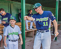 8 July 2014: Vermont Lake Monsters Manager David Newhan gives his son Nico some instruction in the dugout prior to a game against the Lowell Spinners at Centennial Field in Burlington, Vermont. The Lake Monsters rallied with two runs in the 9th to defeat the Spinners 5-4 in NY Penn League action. Mandatory Credit: Ed Wolfstein Photo *** RAW Image File Available ****