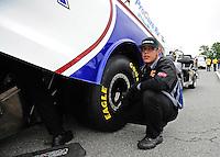 Oct. 2, 2011; Mohnton, PA, USA: NHRA crew member get funny car driver Leah Pruett during the Auto Plus Nationals at Maple Grove Raceway. Mandatory Credit: Mark J. Rebilas-