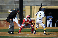 Dylan Lutz (9) of the Quinnipiac Bobcats at bat as Radford Highlanders catcher Jonathan Gonzalez (13) sets a target and home plate umpire Randal Dulin looks on at David F. Couch Ballpark on March 4, 2017 in Winston-Salem, North Carolina. The Highlanders defeated the Bobcats 4-0. (Brian Westerholt/Four Seam Images)
