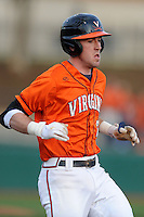 Virginia Cavaliers shortstop Brandon Cogswell #7 runs to first during a game against the Clemson Tigers at Doug Kingsmore Stadium on March 15, 2013 in Clemson, South Carolina. The Cavaliers won 6-5.(Tony Farlow/Four Seam Images).