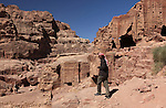 Bedouin climbing the rock-cut tombs on the Street of Facade, in the ancient Jordanian city of Petra. Petra is the most visited tourist attraction in Jordan, a symbol of the country for its historical and archaeological importance. It has been a UNESCO World Heritage Site since 1985.